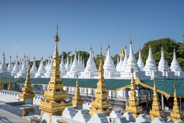 The Sanda Muni Pagoda is a beautiful Golden stupa surrounded by small white pagodas in Mandalay, Myanmar
