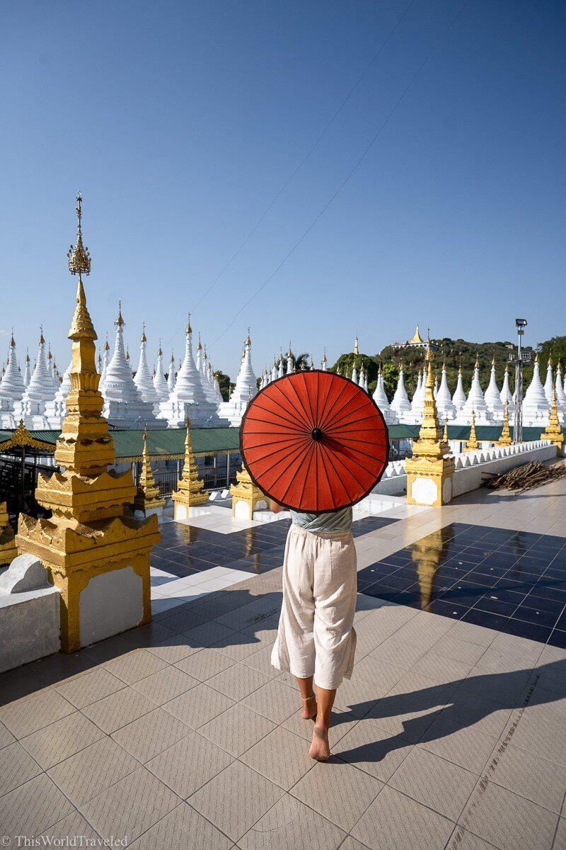 The Sanda Muni Pagoda is a beautiful Golden stupa surrounded by small white pagodas in Mandalay, Myanmar