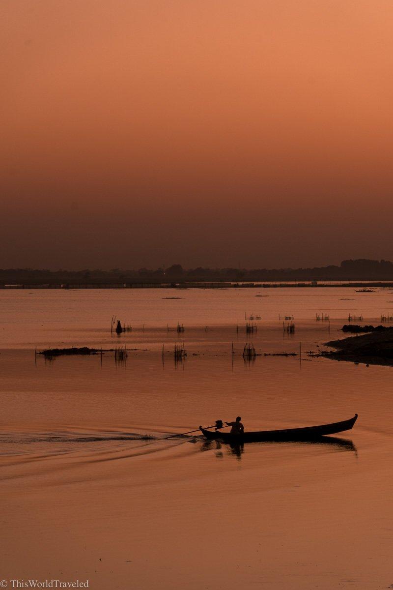 Sunset at the U-Bein bridge in Mandalay, Myanmar