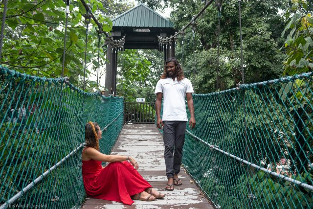 Girl and guy on the canopy at the KL Eco Forest Park in Malaysia