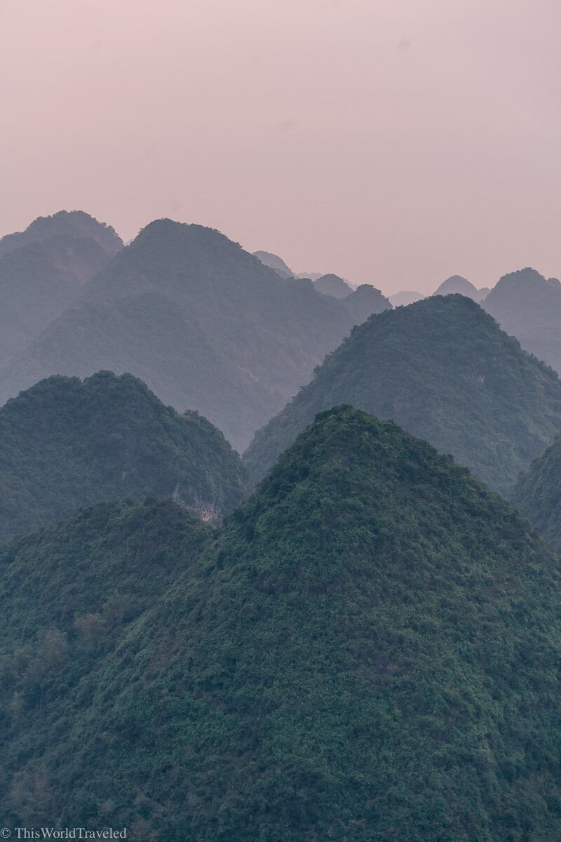 The outline of the limestone cliffs with the sun rising in the back at the Bac Son Valley in Vietnam