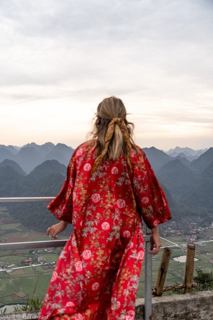 Girl standing at the top of the viewpoint at the Bac Son Valley in Vietnam