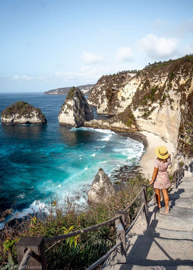 Girl on the stairs that lead down to Diamond Beach Bali