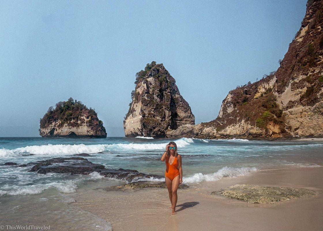 Girl walking in the sand at Diamond Beach on Nusa Penida, Bali