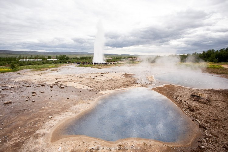 Watching the geysir blow on Iceland's Golden Circle