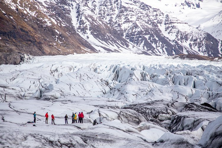 Hiking along the glacier in southern Iceland in the winter