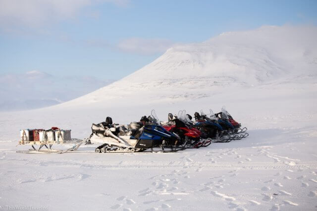 Snowmobiles lined up in front of the Templefjorden in Svalbard