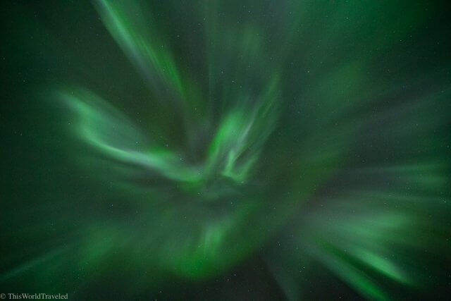 The bright green color of the northern lights dancing in the sky in Tromsø, Norway