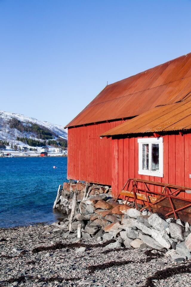 The red fisherman house on a fjord in Tromsø, Norway