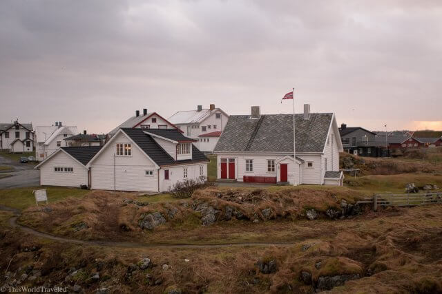 The picturesque town of Andenes, Norway with the traditional white and red wooden houses