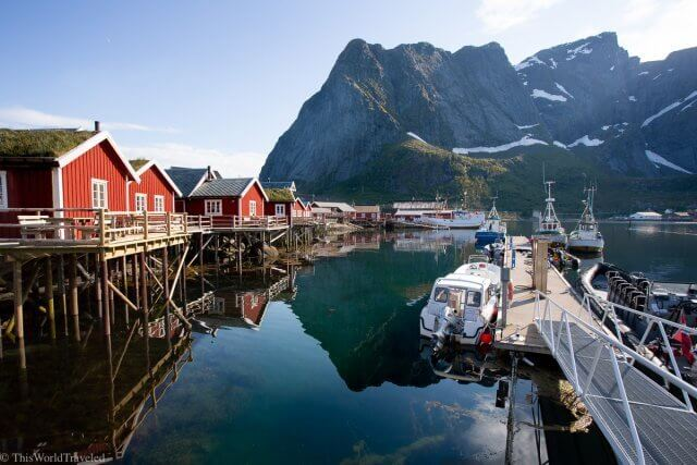 Red fisherman huts on the fjord in Reine, Lofoten Islands, Norway