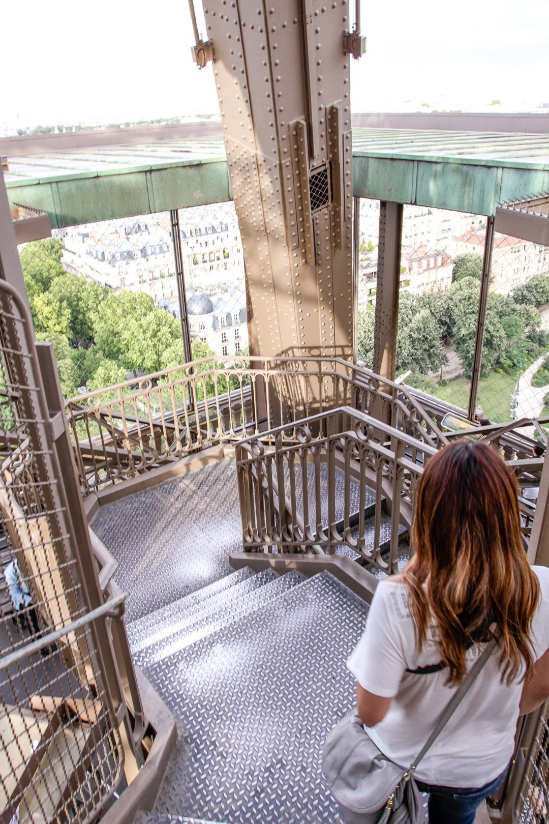 Girl climbing the stairs inside the Eiffel Tower in Paris