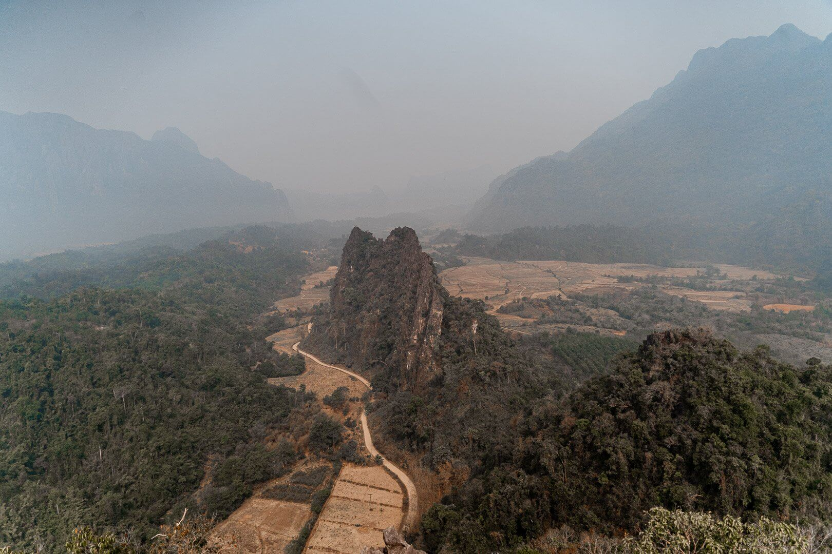 Nam Xay viewpoint in Vang Vieng. The viewpoint is famous for the large, protruding cliff in the middle of the valley