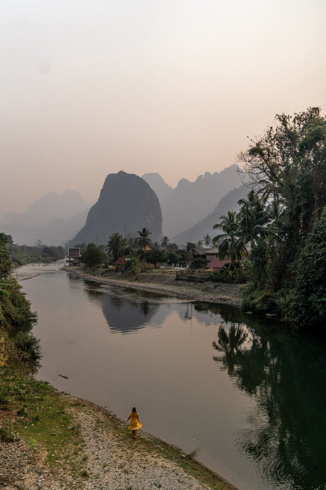 Girl by the water at the Pha Tang village near Vang Vieng in Laos