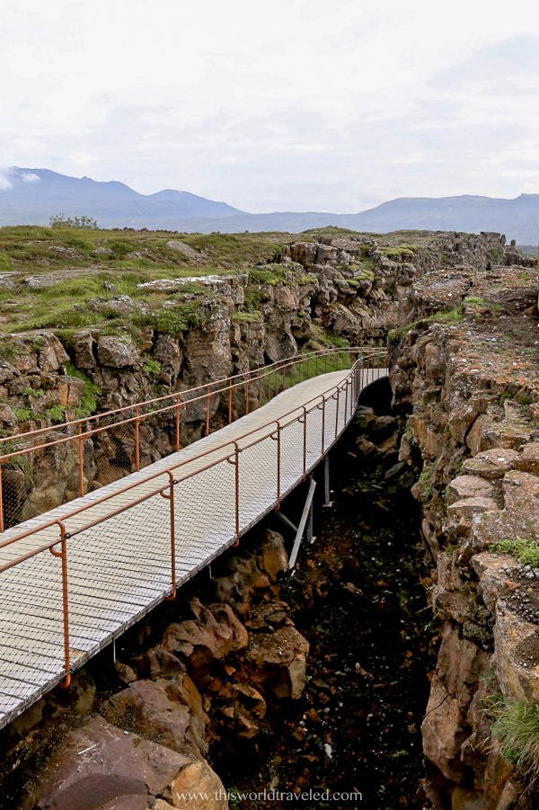 Walking between the tectonic plates in Thingvellir National Park, Iceland