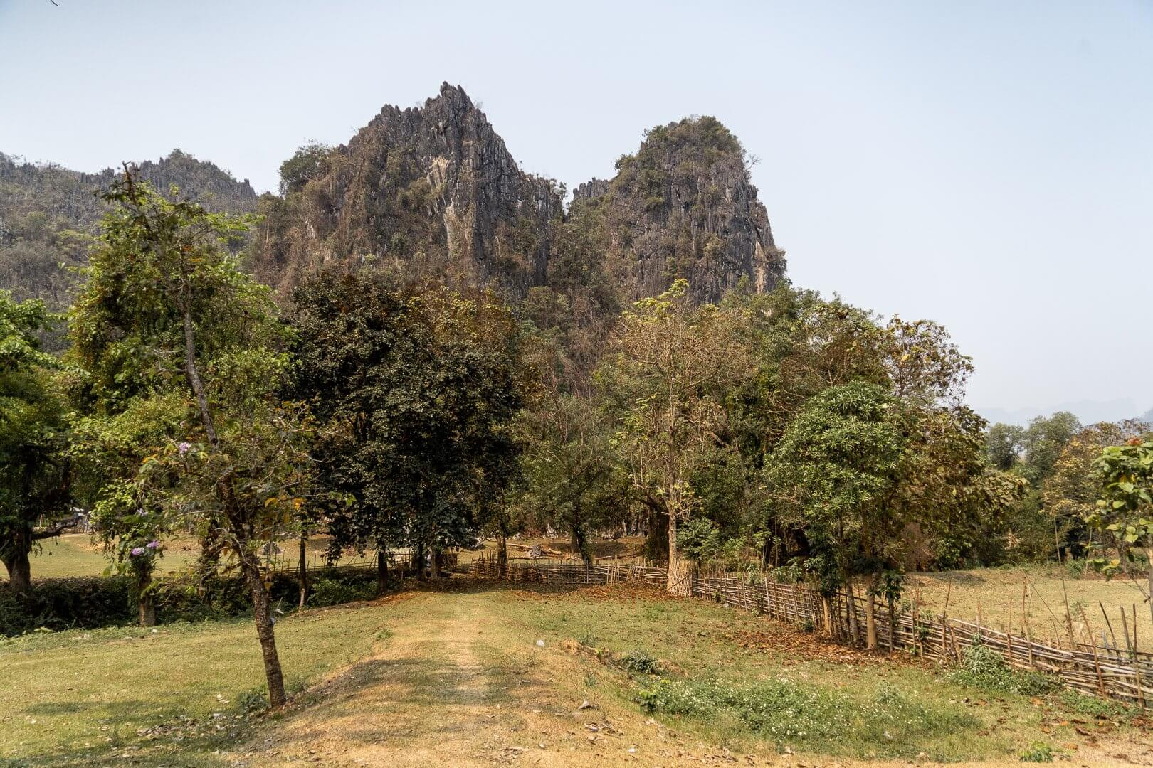 The large limestone cliffs that surround the town of Vang Vieng in Laos