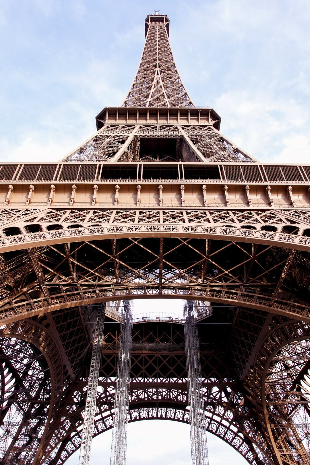 View of the Eiffel Tower in Paris, France from underneath