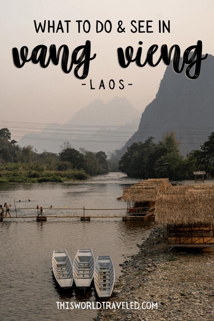 Limestone cliffs and a small bamboo bridge at the Pha Tang Village near Vang Vieng in Laos