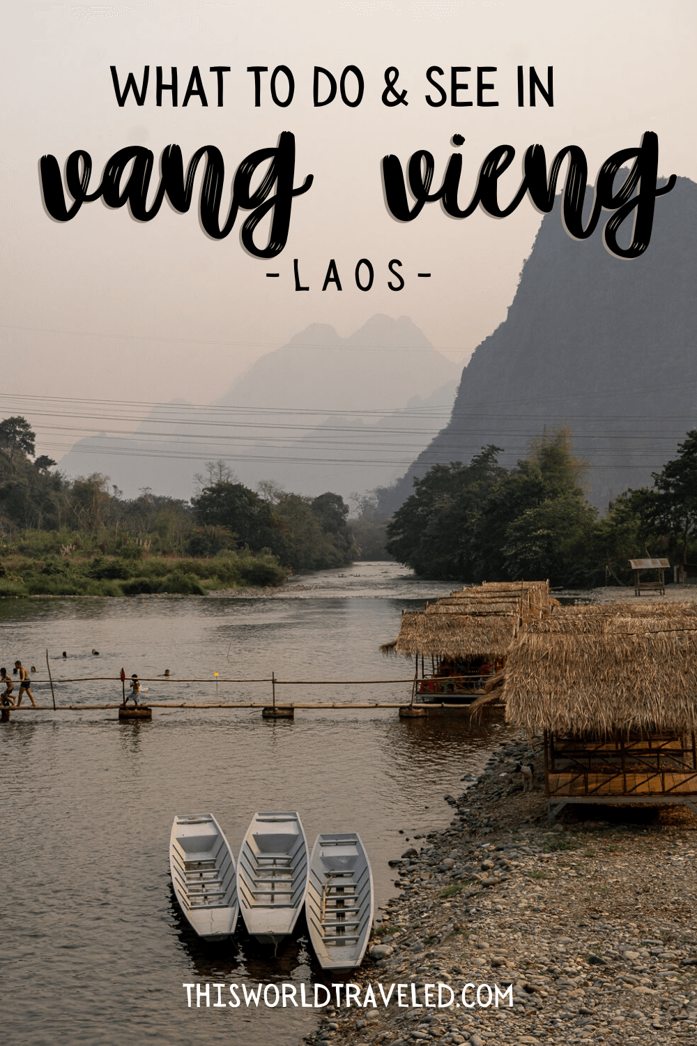 Limestone cliffs and a small bamboo bridge at the Pha Tang Village near Vang Vieng in Laos