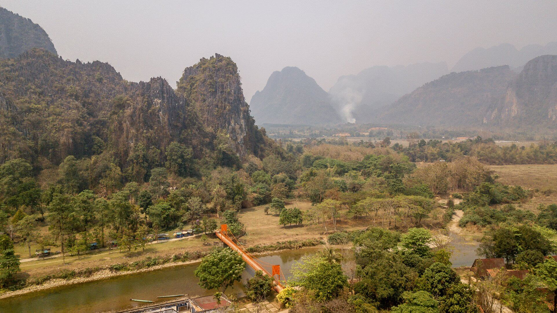 Drone shot of the orange pedestrian bridge in Vang Vieng, Laos