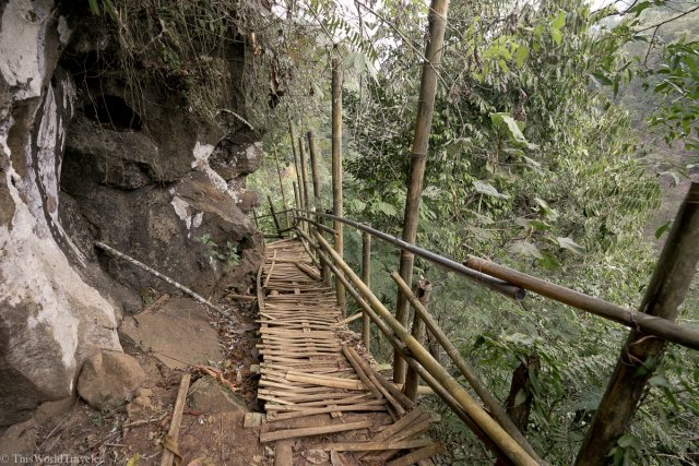 The bamboo stairs that lead down to the Tumpak Sewu waterfall in East Java, Indonesia