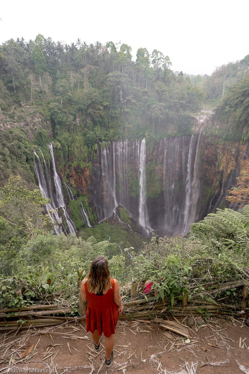 Girl standing in front of Tumpak Sewu from the panoramic viewpoint