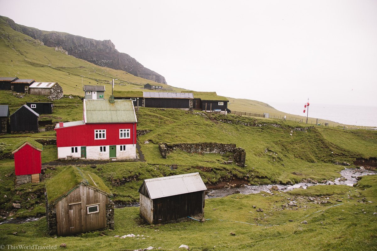 You'll start your hike to the Hólmur lighthouse from Mykines village in the Faroe islands