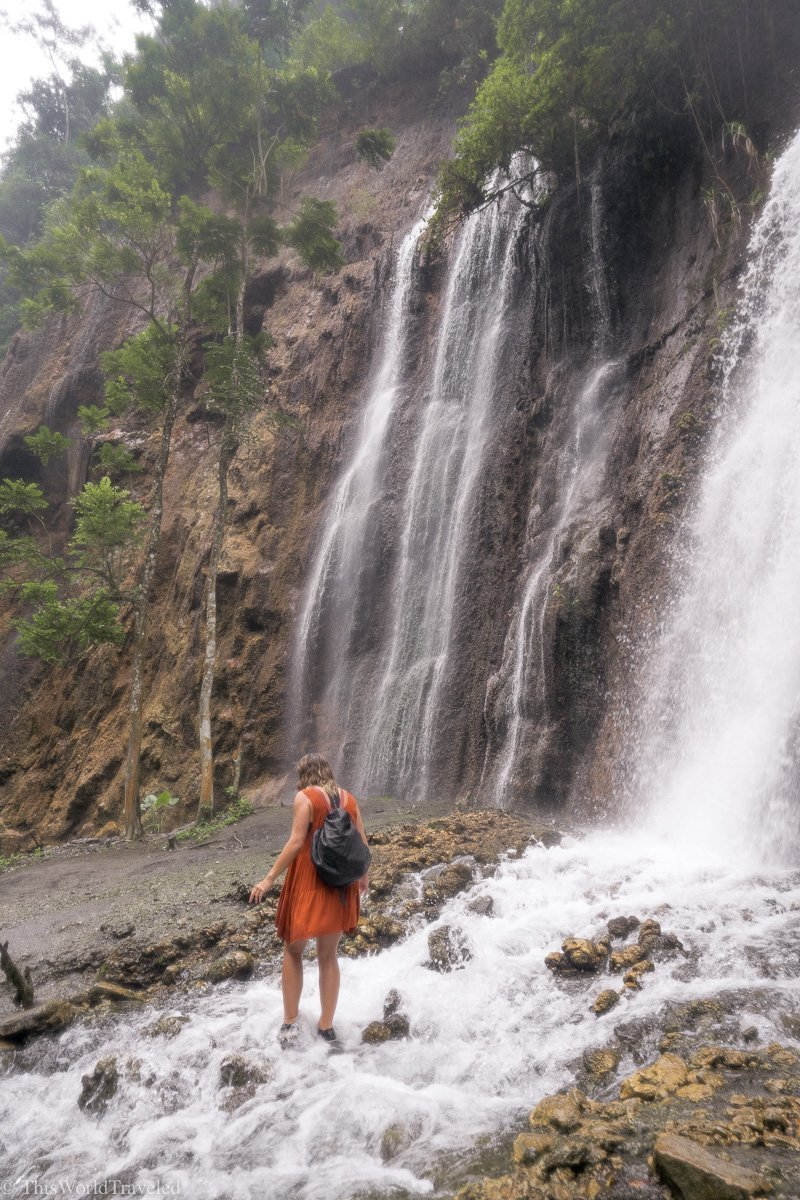 The hike to get to the Tumpak Sewu waterfall involves walking through streams of water