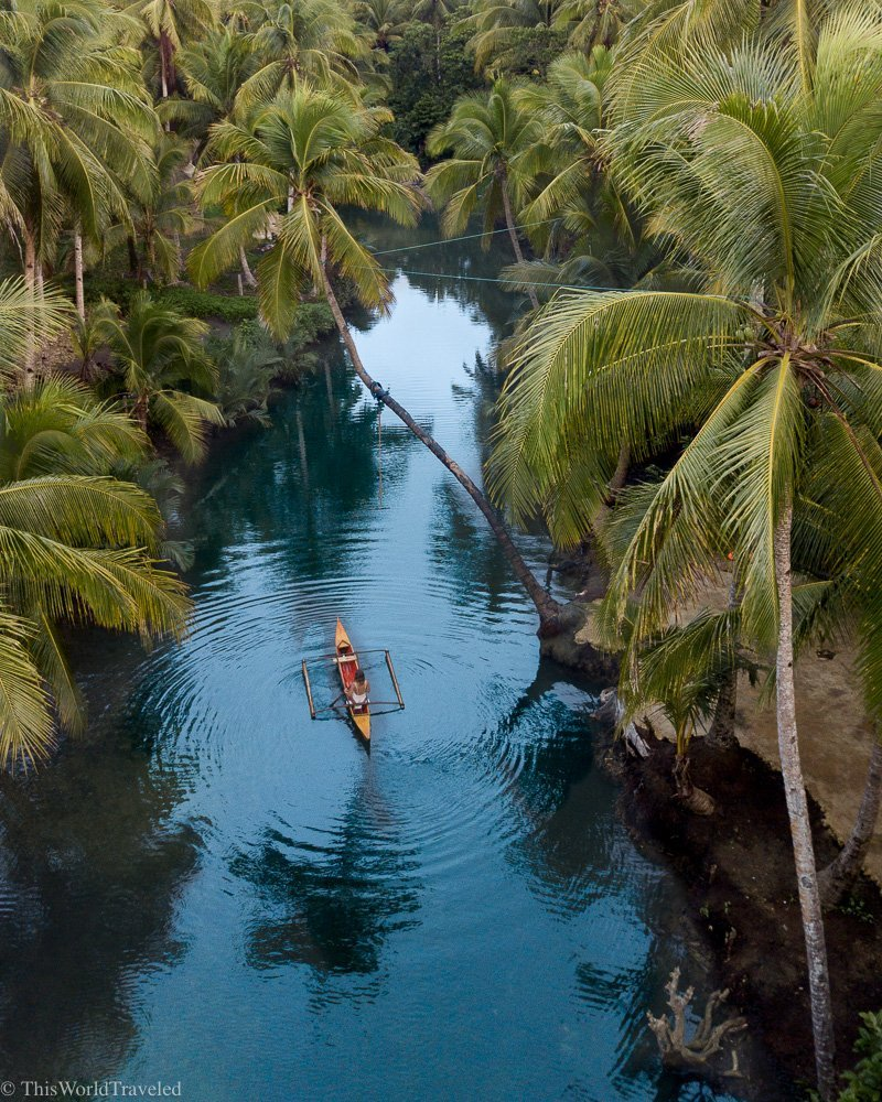 Girl sitting in a bamboo boat on the Maasin River in Siargao
