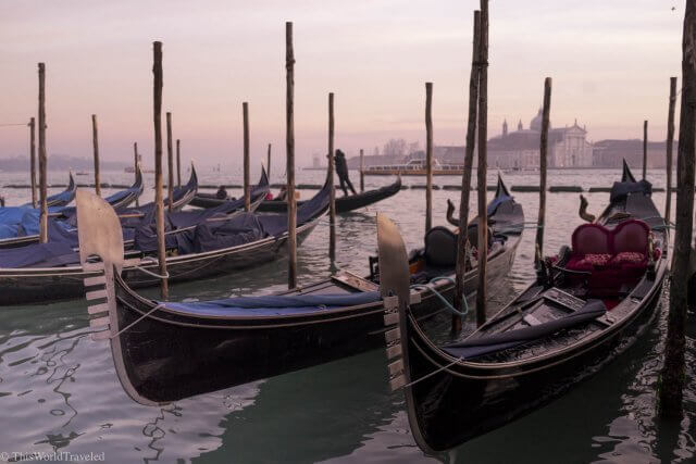 A row of gondolas along the grand canal in Venice, Italy