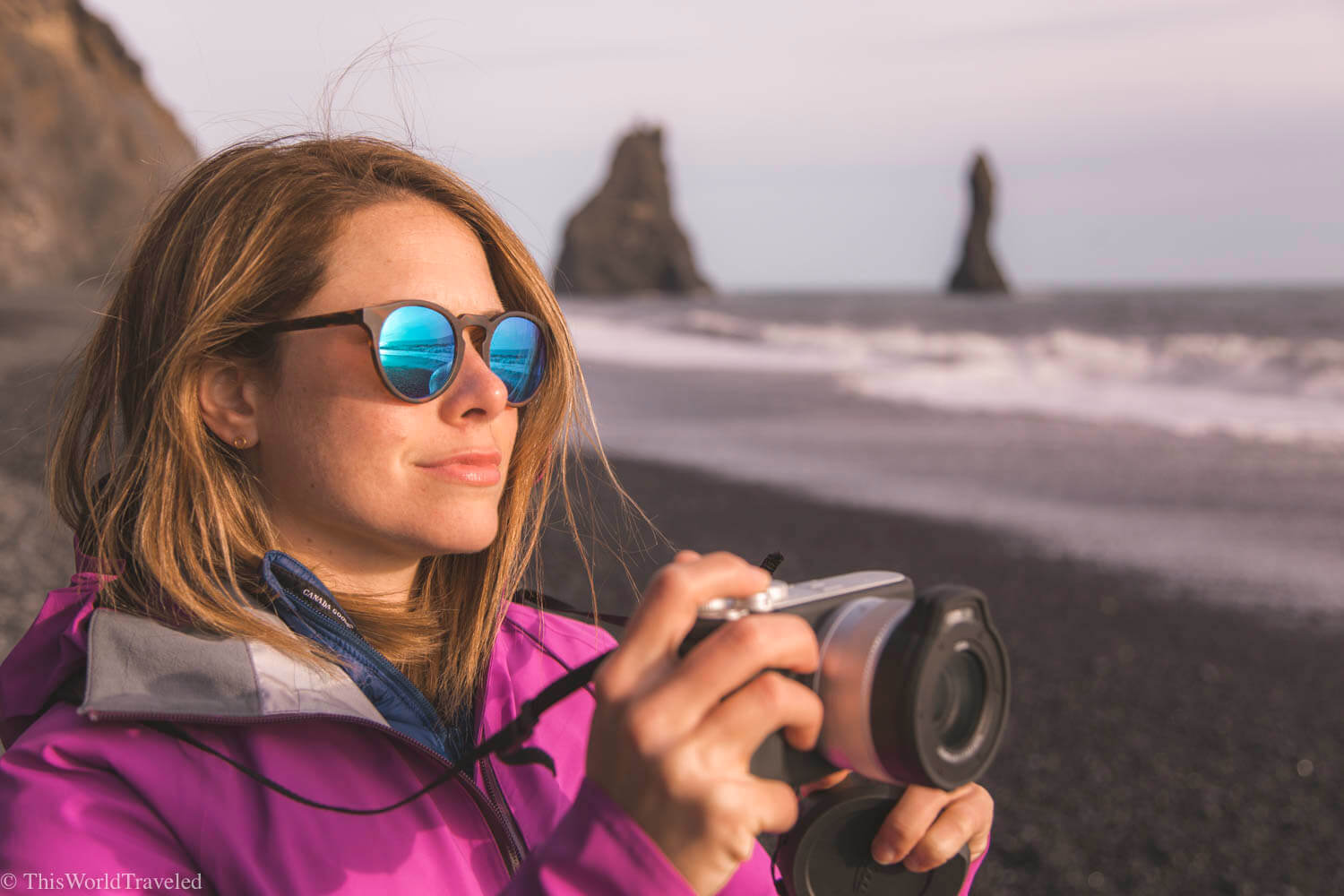 Girl with a Leica XU camera in hand at the black sand beach in Iceland
