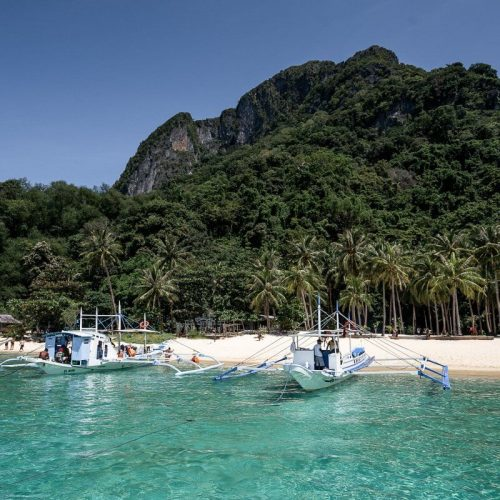 The turquoise water and white sand beaches of El Nido Palawan in the Philippines