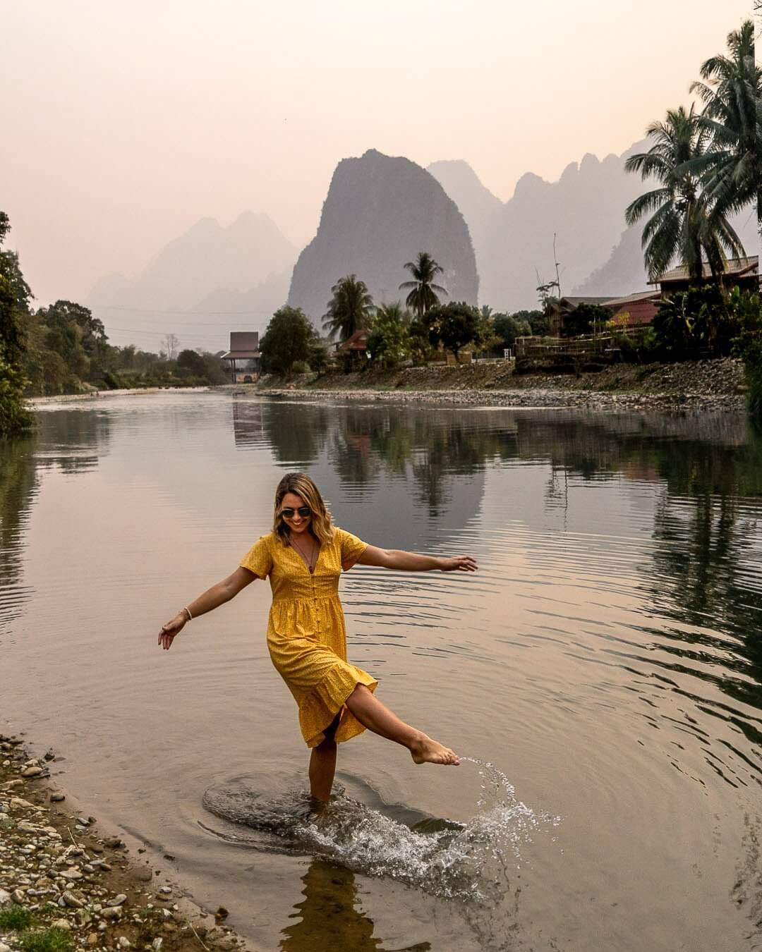 Girl in the water at the Nam Song river in Vang Vieng, Laos
