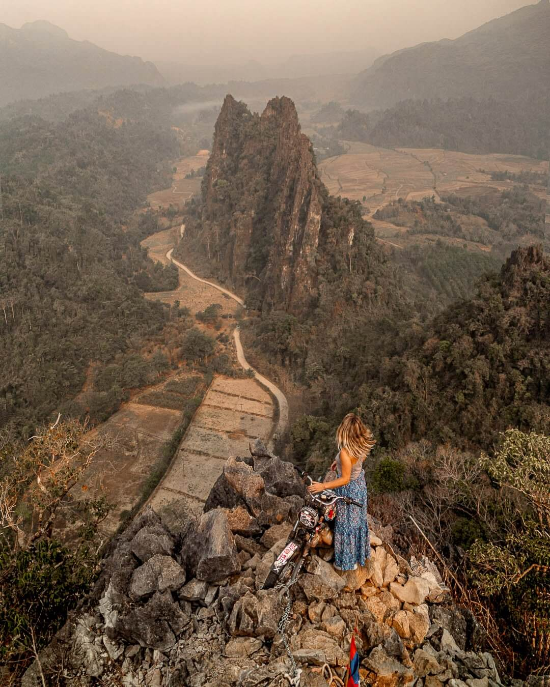 Girl with a blue skirt at the Nam Xay viewpoint in Vang Vieng, laos