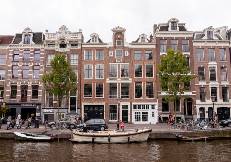 The canals of Amsterdam and the leaning row houses that line the canal are places that you can see when planning a trip to Europe
