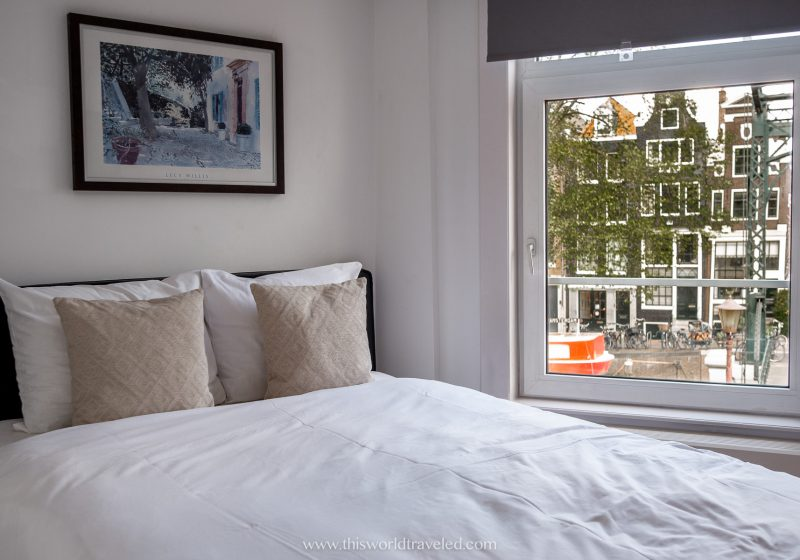 Hotel room in Amsterdam with a view of the row houses and canals