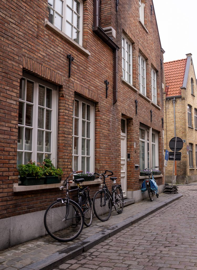 A small street lined with Bicycles in Brugge, Belgium