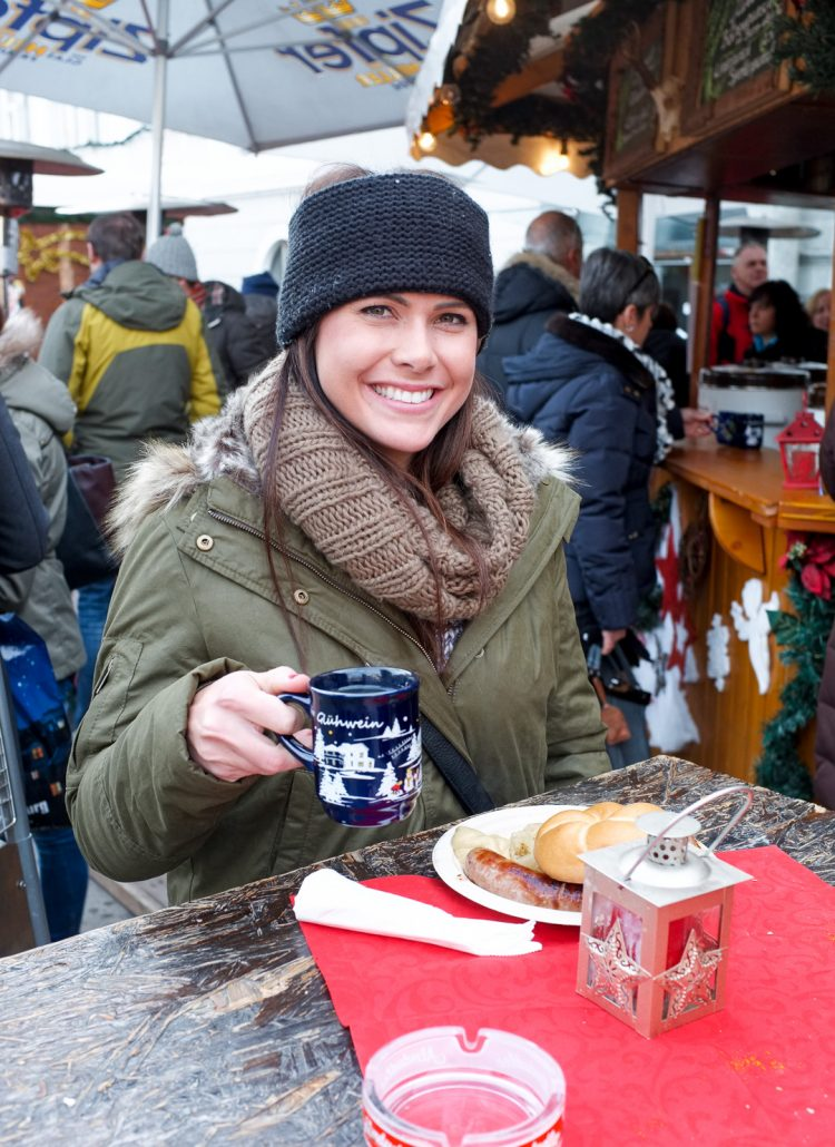 Girl enjoying food at the Christmas Markets in Austria