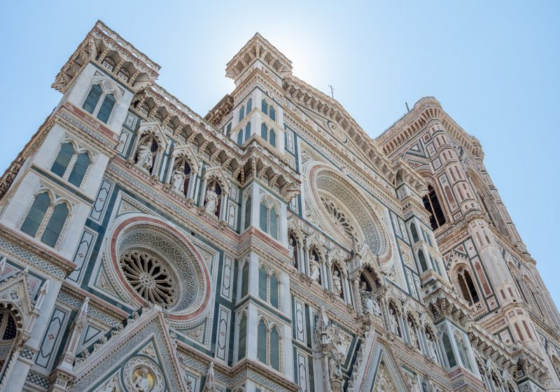 The pink and green exterior of the Duomo in Florence, Italy