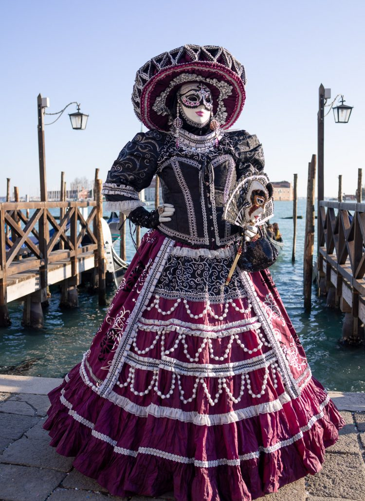 Visit Venice, Italy in February to attend the annual Carnival festival when planning a trip to Europe