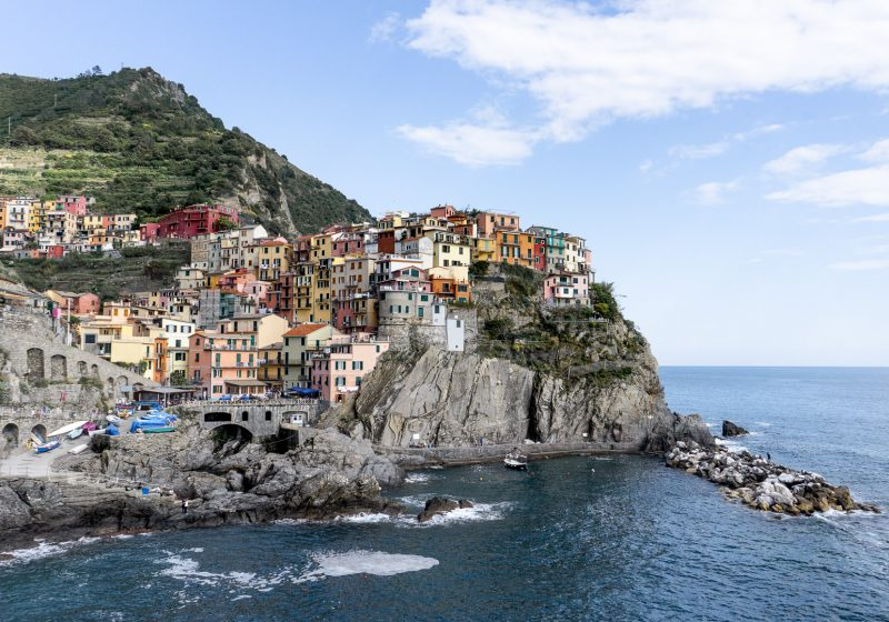 The town of Manarola in Cinque Terre along the Italian Riviera is a place you can visit while planning a trip to Europe
