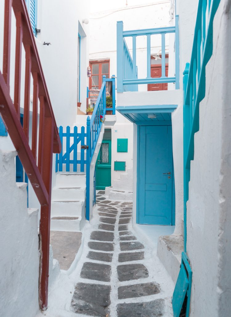 The colorful streets with white-washed buildings in Mykonos, Greece
