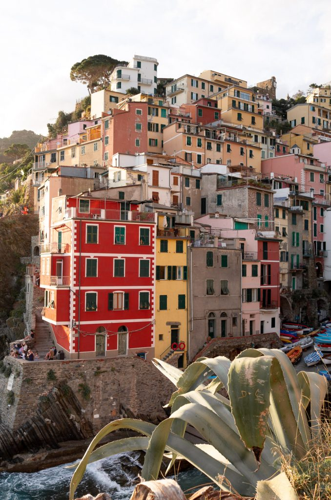 Colorful buildings located along the Ligurian sea in Italy's Cinque Terre. This is the town of Riomaggiore