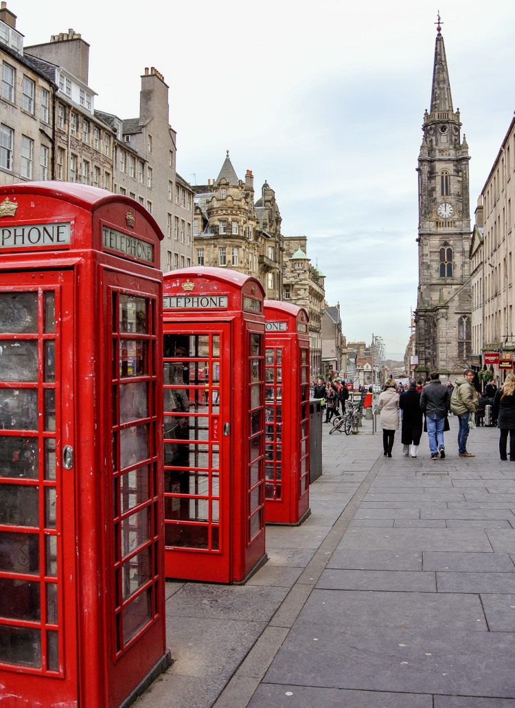 The Royal Mile with red phone booths in Edinburgh, Scotland