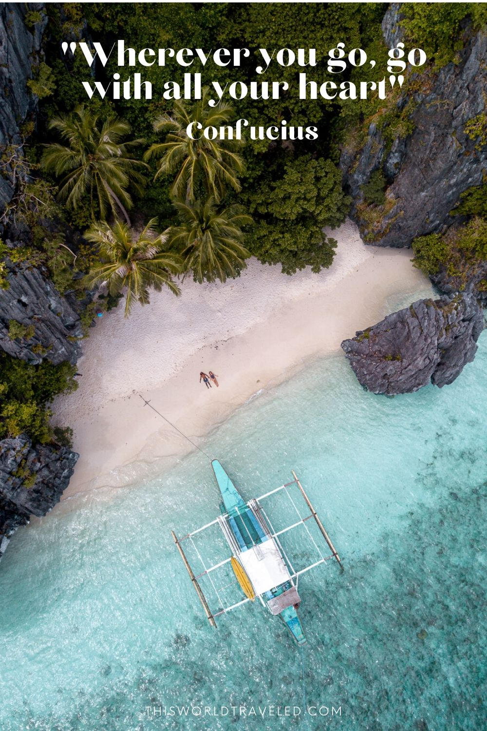 Picture of a couple lying on the beach at Entalula Island in El Nido, the Philippines