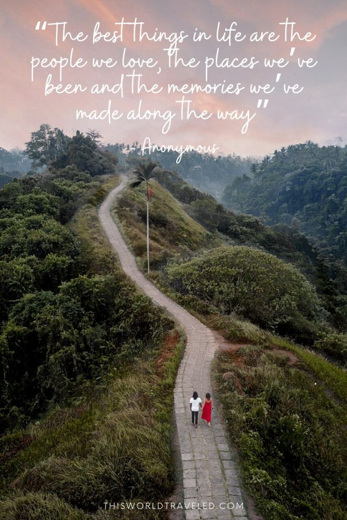 Picture of a couple walking along the Campuhan Ridge walk in Ubud, Bali with a travel quote overlay
