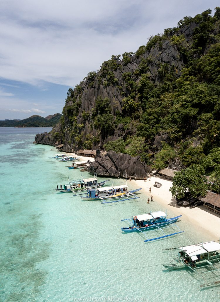 The small beach huts on the sand at Banul Beach in Coron, Philippines