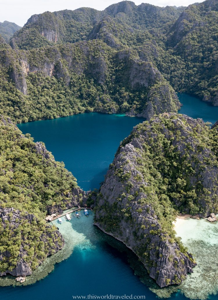 Massive limestone cliffs and turquoise water at the entrance of Barracuda Lake in Coron