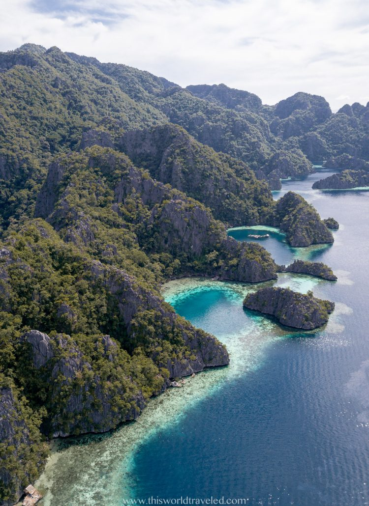 Views of Coron in the Philippines with towering limestone cliffs and turquoise water