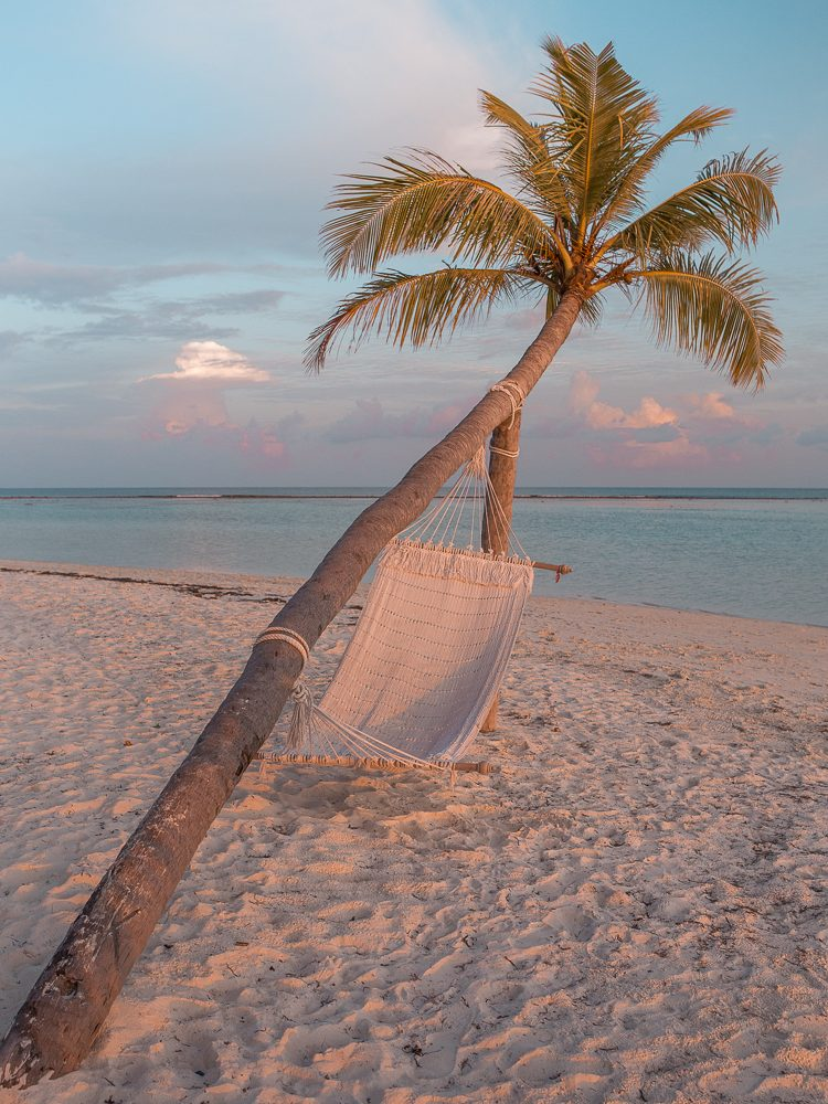 Hammock on Dhangethi beach in the Maldives at sunset